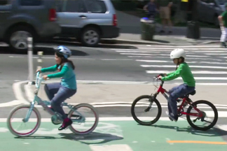 two children riding on bikes
