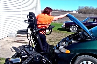woman in action track chair closing car hood