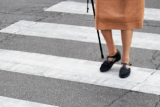 closeup of woman legs at crosswalk