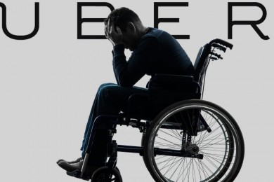 person in a wheelchair with hands to face
