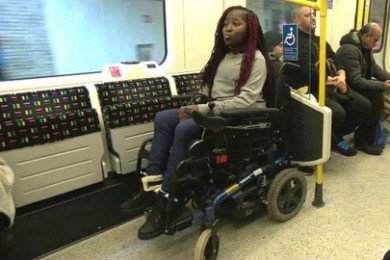 woman in wheelchair on train