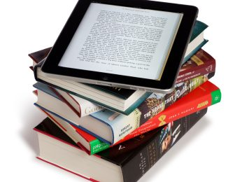 ipad on a stack of books
