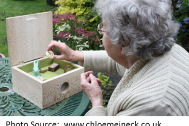 older woman interacting with a music memory box