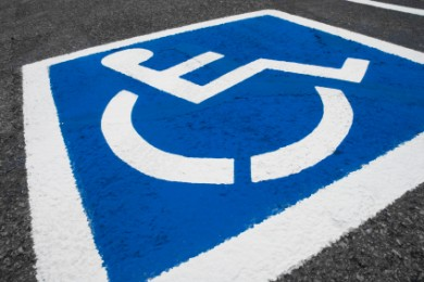 wheelchair accessible sign on pavement
