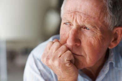 Closeup of an elderly man looking away in deep thought, depression