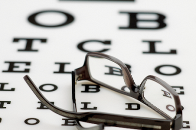 glasses on top of eye test chart