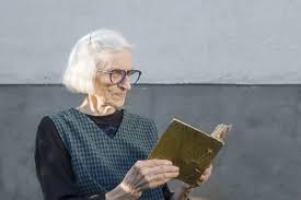 older female reading a book