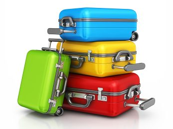 luggages stacked on top of each other, one leaning on stack
