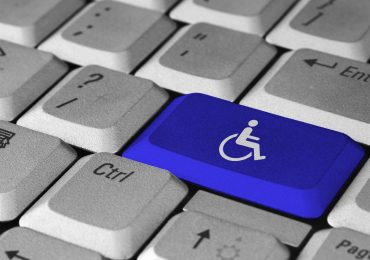 wheelchair user symbol on 'enter' button of typical keyboard