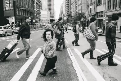 a little person walking on crosswalk in city