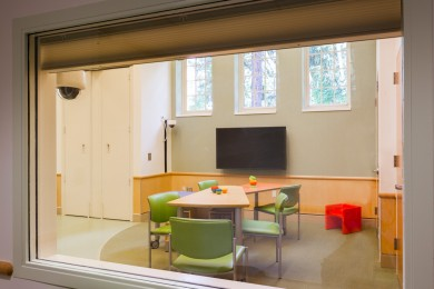 colorful furniture and carpeting in a room designed for autism