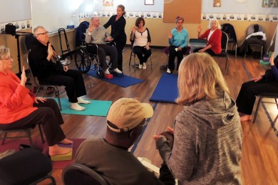 a circle of adults with traumatic brain injury and staff doing yoga