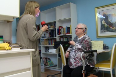 Bonnie Heath, left, interprets for Gayle Northcott, right, in Northcott's current home in Winnipeg.
