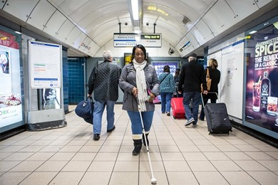 blind woman walking with a cane
