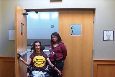 woman in wheelchair entering a doorway