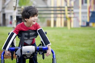 a child in walker smiling