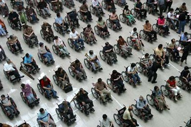 aeriel view of people in wheelchairs lined up on concrete pavement