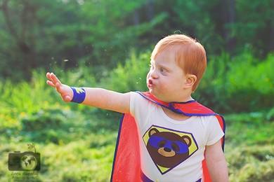 child dressed up as a superhero