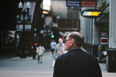 back of a man's head in streetscape background