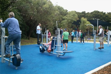 seniors exercising in playground