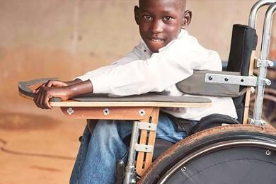 child sitting in wheelchair