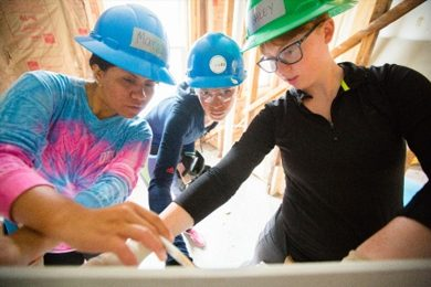 University at Buffalo architecture and planning students work on a Habitat for Humanity home on Buffalo's East Side in June 2016.