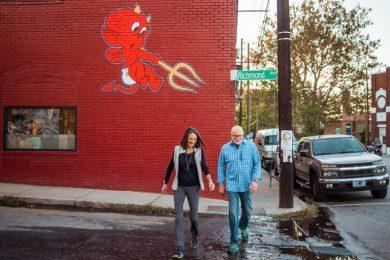 couple walking across street