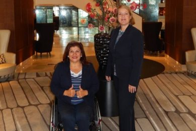 woman in wheelchair and standing woman next to her