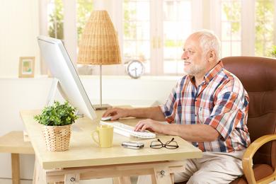 elderly man using a computer