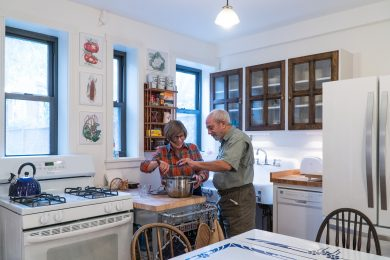 elderly couple cooking in the kitchen