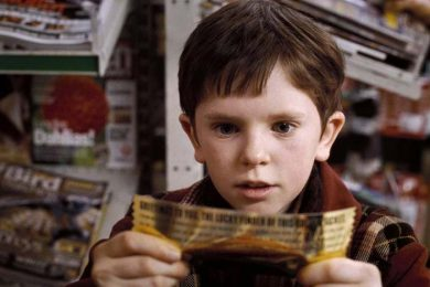 boy from charlie and the chocolate factory looking at a note