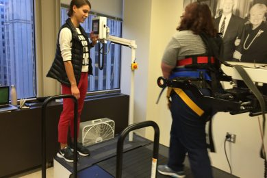 Ashley Bobich, left, working with Christine Bowers at the Shirley Ryan AbilityLab on learning to prevent falls.