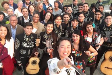 The conference's Greater Dallas field trip destinations included a visit to the Margaret Hunt Hill Bridge and Trinity Groves area, where attendees encountered a youth mariachi band.