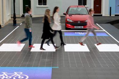 People walking across crosswalk in London
