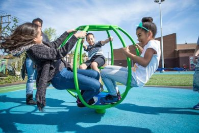 Children play in a schoolyard converted to a community playground in Philadelphia.