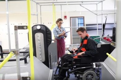 Individual testing wheelchair on public transportation system-another individual is tracking information on the test.