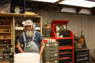 George Wurtzel in his workshop at Enchanted Hills Camp
