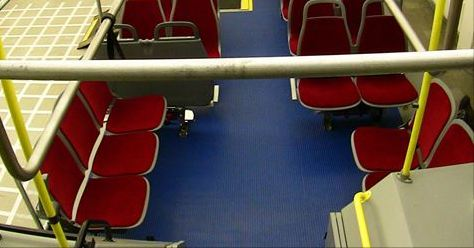 Red public transit seats, and isle.