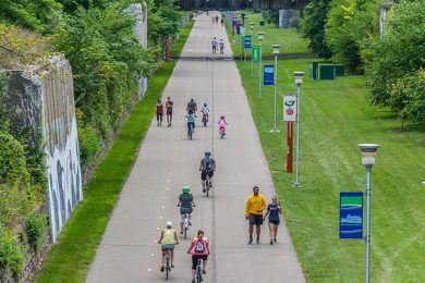 Cyclists and pedestrians enjoy the Dequindre Cut, an important part of Detroit's riverfront greenway system.