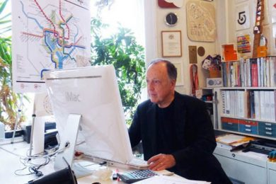 Lance Wyman looking at a computer screen