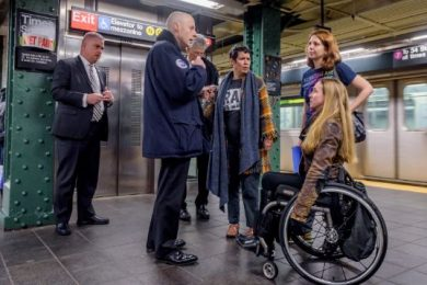 An activist from the Elevator Action Group with Rise and Resist speaking to NYCT President Andy Byford