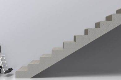 Wheelchair facing a staircase representing a barrier