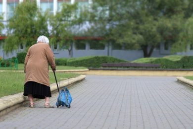 elderly women walking on brick walkway