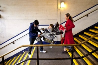 Carrying a push chair down the stairs in a London tube station