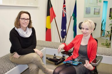 Co-author Harmony Turnbull with Fiona Bridger, who has cerebral palsy and uses a speech generating device