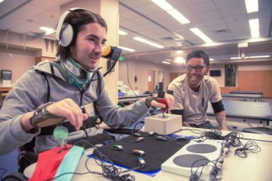 A young man operates an Xbox Adaptive Controller, which makes gaming accessible to people with a broad range of disabilities.