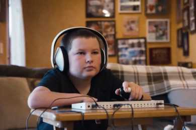 Young boy using the new Microsoft Adaptive Controller for Xbox One