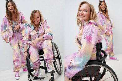 Two girls in matching jumpsuits, one of which is in a wheelchair