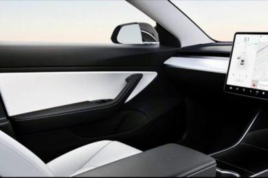 Interior of Teslas Autonomous vehicle, featuring no steering wheel