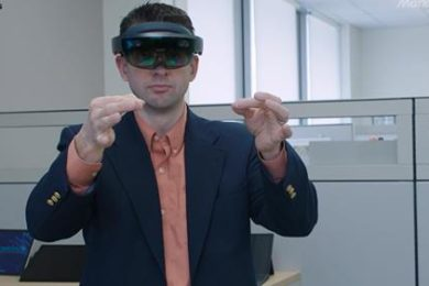 man wearing simulation goggles, demonstrating augmented reality